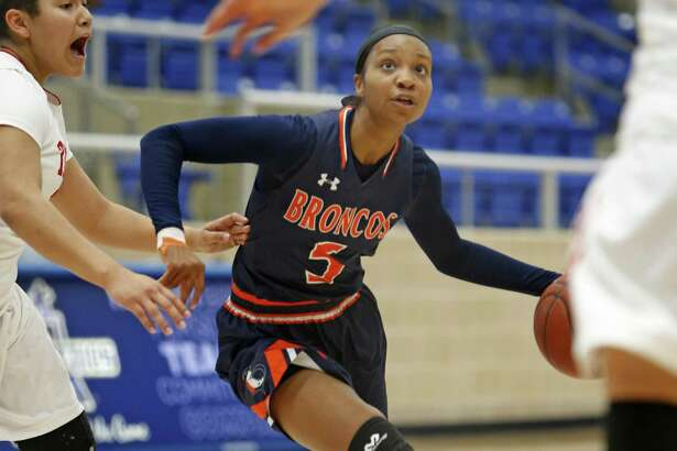 Brandeis' Gabby Connally (5) drives against Taft in a District 28-6A game on Jan. 14, 2017 at Northside ISD Gym.