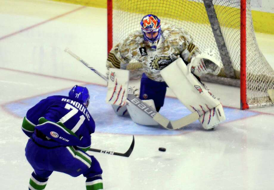 Sound Tigers goalie Jaroslav Halak prepares to block a goal attempt by Utica Comets' Borna Rendulic during hockey action at the Webster Bank Arena in Bridgeport, Conn., on Saturday Jan. 14, 2017. Photo: Christian Abraham / Hearst Connecticut Media / Connecticut Post