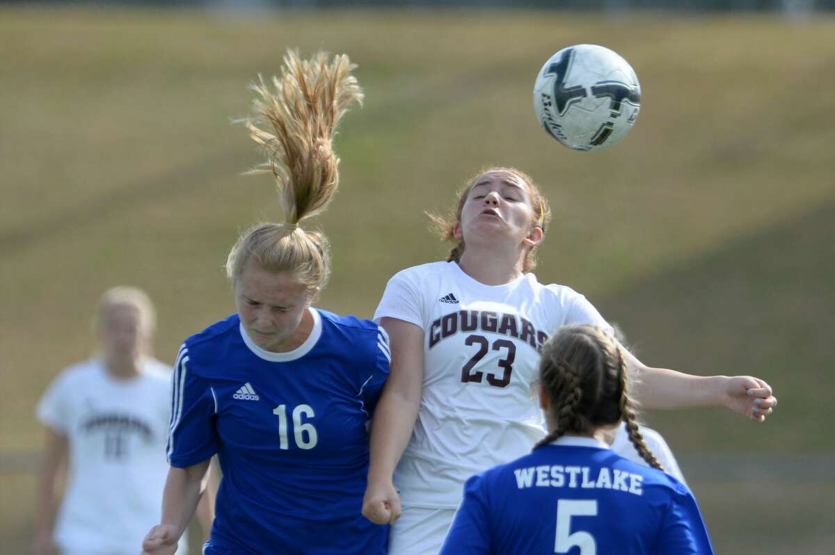 Abby Mccain (23) of Cinco Ranch and Addie Hackney (16) of Westlake fight for a header during the first half of the Cougar Bracket Championship Game of the Typhoon Texas/I-10 Shootout between the Cinco Ranch Cougars and the Austin Westlake Chapparals on Saturday January 14, 2017 at Rhodes Stadium, Katy, TX.