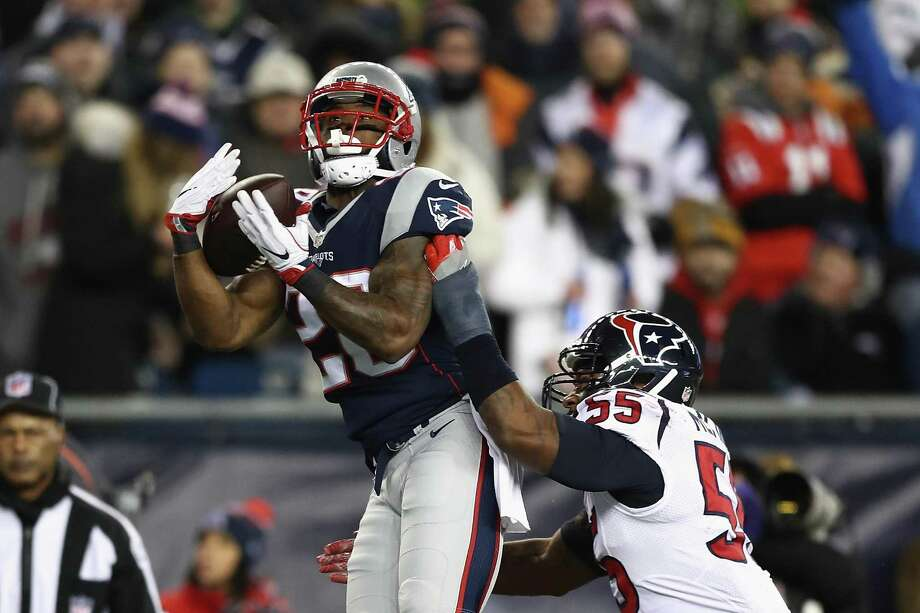 FOXBORO, MA - JANUARY 14: James White #28 of the New England Patriots catches a pass for a touchdown in the third quarter against the Houston Texans during the AFC Divisional Playoff Game at Gillette Stadium on January 14, 2017 in Foxboro, Massachusetts.  (Photo by Elsa/Getty Images) Photo: Elsa, Staff / Getty Images / 2017 Getty Images