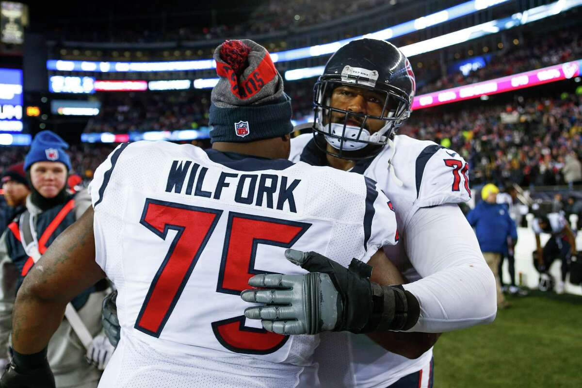 Houston Texans nose tackle Vince Wilfork (75) hugs Houston Texans tackle Duane Brown (76) after losing an AFC Divisional Playoff game at Gillette Stadium on Saturday, Jan. 14, 2017, in Foxborough.