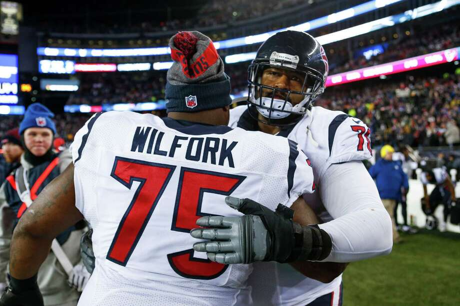 Houston Texans nose tackle Vince Wilfork (75) hugs Houston Texans tackle Duane Brown (76) after losing an AFC Divisional Playoff game at Gillette Stadium on Saturday, Jan. 14, 2017, in Foxborough. Photo: Brett Coomer, Houston Chronicle / © 2017 Houston Chronicle