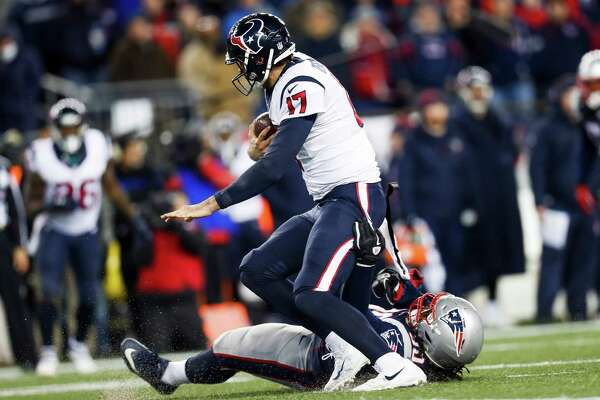 New England Patriots defensive tackle Malcom Brown (90) sacks Houston Texans quarterback Brock Osweiler (17) during the fourth quarter of an NFL divisional playoff game at Gillette Stadium, Saturday, January 14,  2017.