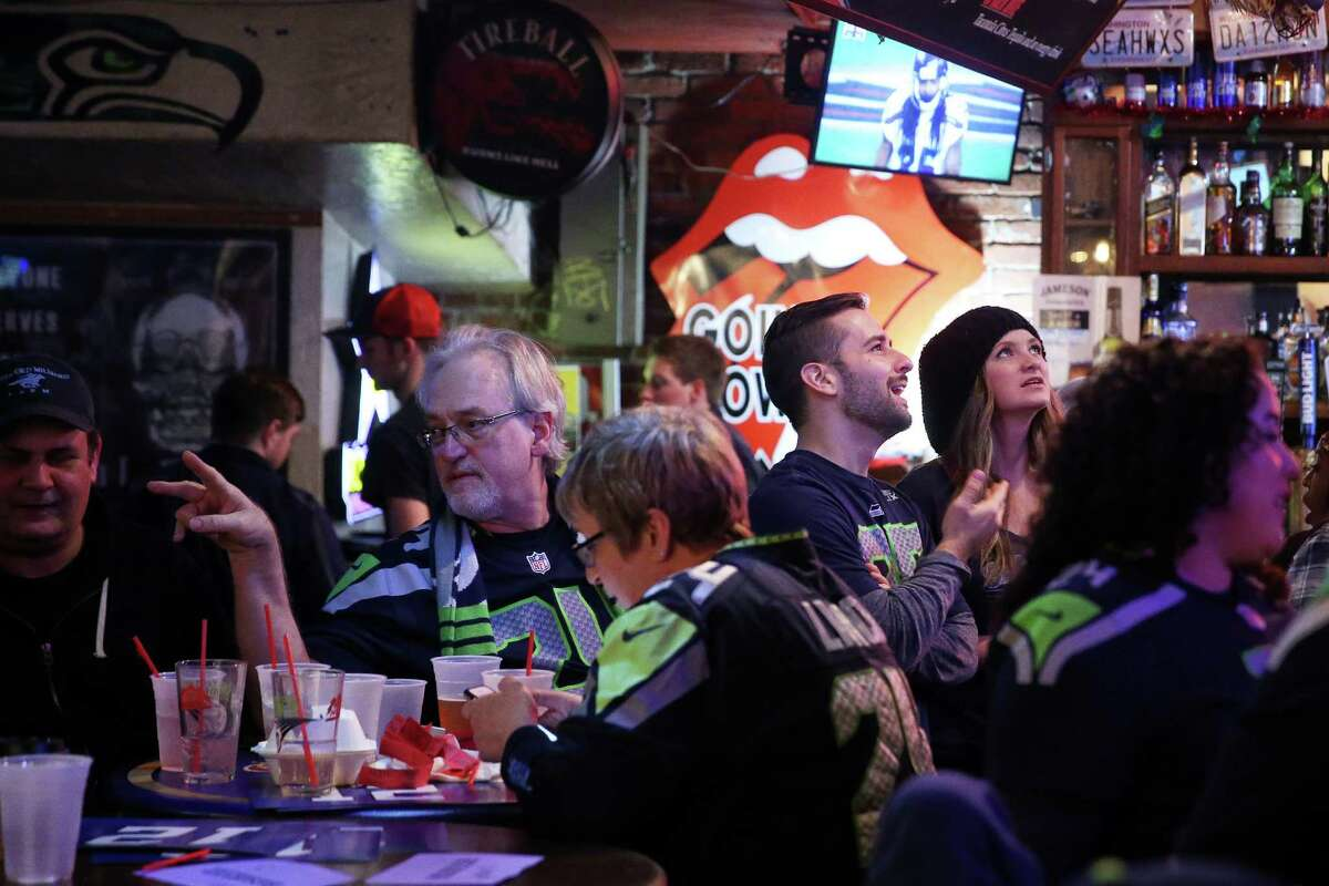 Seahawks fans watch the second half of Seattle's playoff game against the Atlanta Falcons, Saturday, Jan. 14, 2017 at King Street Bar and Oven.
