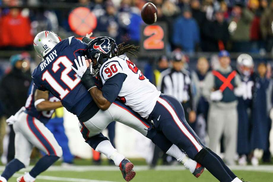 Texans defensive end Jadeveon Clowney (90) was a thorn in the side of Patriots quarterback Tom Brady on Saturday night. Photo: Brett Coomer, Staff / © 2017 Houston Chronicle