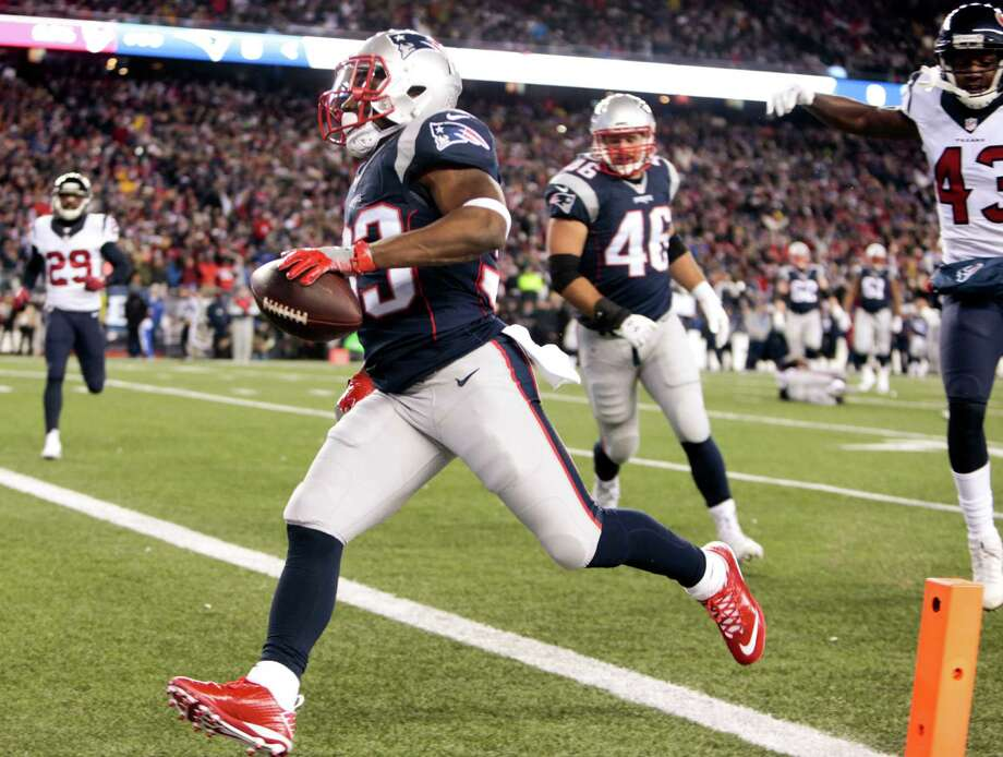 New England Patriots running back Dion Lewis (33) runs across the goal line past Houston Texans strong safety Corey Moore (43) for a 13-yard touchdown reception during the first quarter of an AFC Divisional Playoff game at Gillette Stadium on Saturday, Jan. 14, 2017, in Foxborough. Photo: Brett Coomer, Houston Chronicle / © 2017 Houston Chronicle