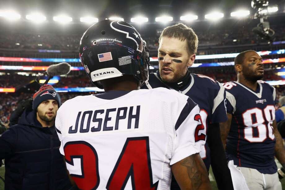 FOXBORO, MA - JANUARY 14: Tom Brady #12 of the New England Patriots greets Johnathan Joseph #24 of the Houston Texans after the Patriots 34-16 victory over the Texans in the AFC Divisional Playoff Game at Gillette Stadium on January 14, 2017 in Foxboro, Massachusetts.  (Photo by Elsa/Getty Images) Photo: Elsa/Getty Images