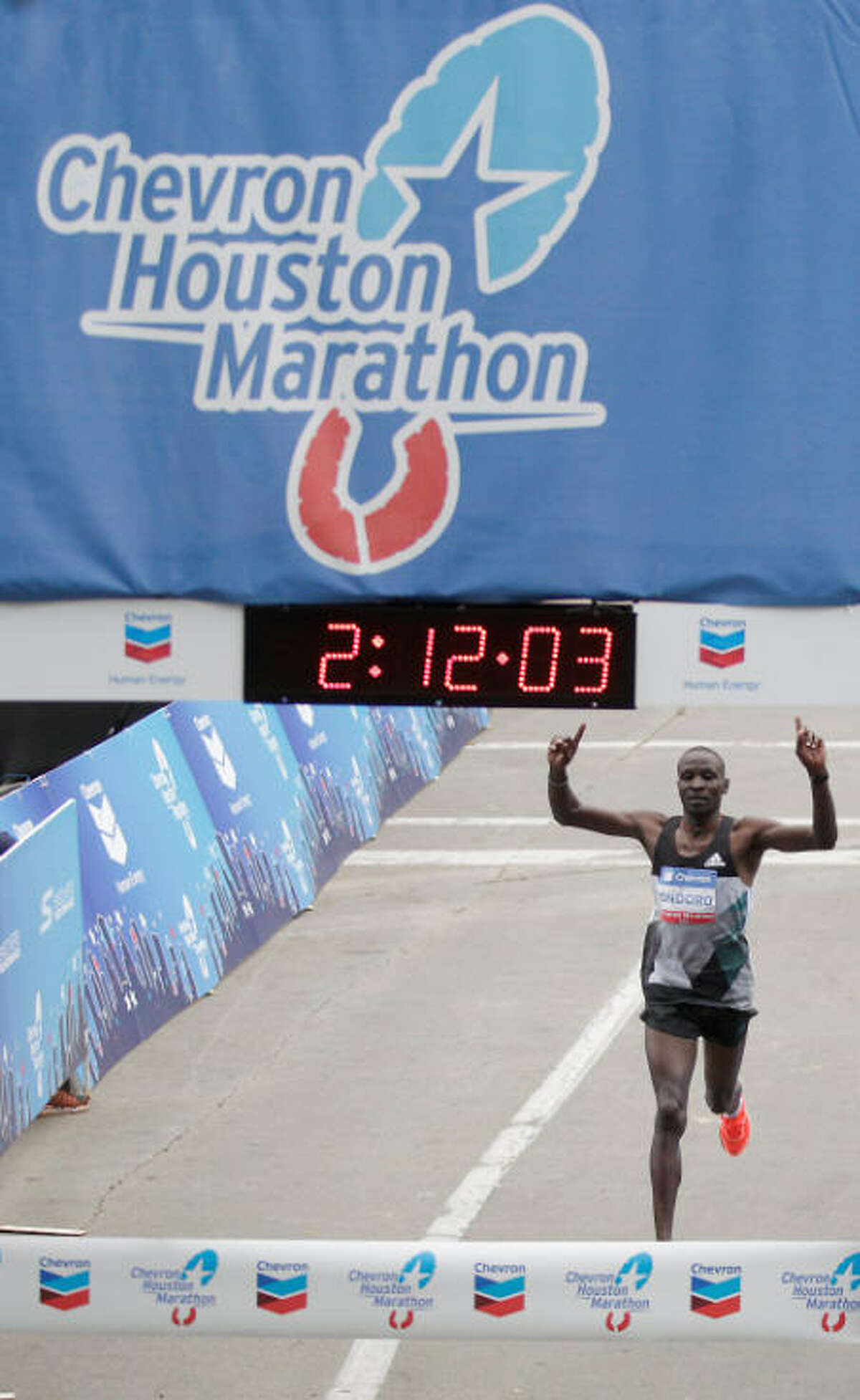 Kenyan Dominic Ondoro took the men's division in the Chevron Houston Marathon in 2 hours and 12 minutes.