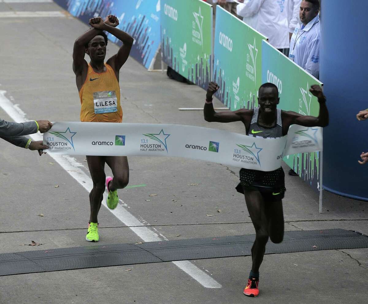 Leonard Korir of USA reacts as he edges out Feyisa Lilesa Gemechu of Ethiopia to win the Houston Half Marathon on Sunday, Jan. 15, 2017, in Houston.