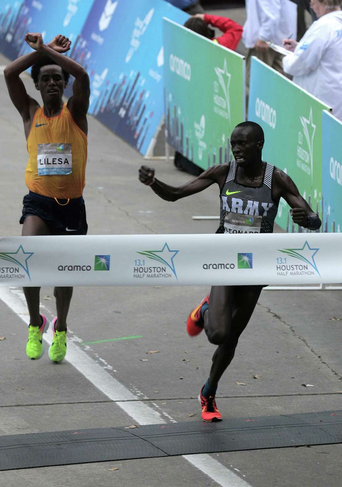Leonard Korir of USA edges out Feyisa Lilesa Gemechu of Ethiopia to win the Houston Half Marathon on Sunday, Jan. 15, 2017, in Houston.