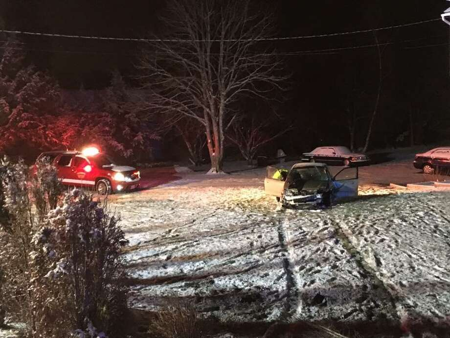 Firefighter and emergency personnel responded to an accident in Monroe Saturday evening, which sent one car off the road, but didn't seem to seriously hurt anyone. Photos courtesy of the Monroe volunteer fire department. Photo: Contributed / Contributed