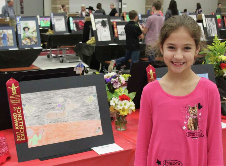 """Alyssa Jones is a Cleveland ISD fourth-grade student whowon second place with her work titled """"Rodeo Talent Show."""" Photo: Jacob McAdams"""