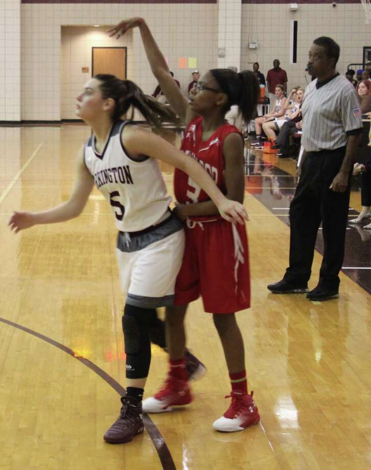 Kadyra Wilridge (3) of the Lady Indians makes a shot over the head of LadyHorn Karlee Fails (5). Photo: Jacob McAdams