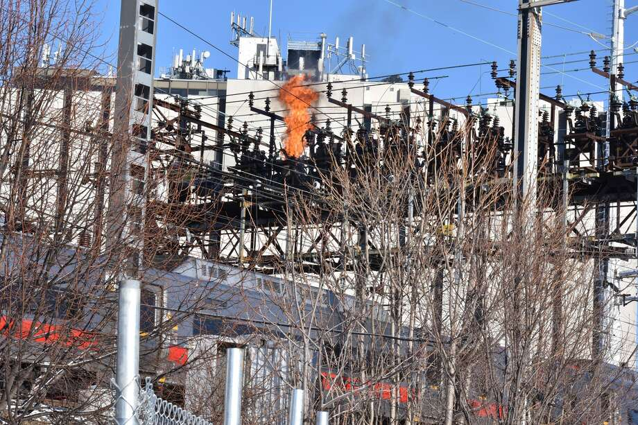 A transformer exploded and burned Sunday morning above New Haven Line railroad tracks in South Norwalk, resulting in service delays that extended into the afternoon. Photo: Harold F. Cobin