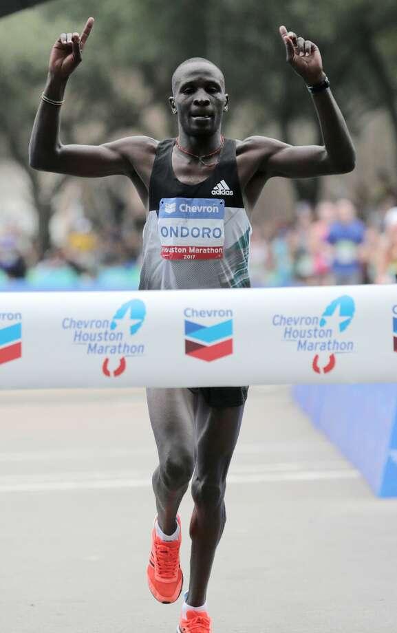 Dominic Ondoro of Kenya crossing the finish line to win the Chevron Houston Marathon on Sunday, Jan. 15, 2017, in Houston. ( Elizabeth Conley / Houston Chronicle ) Photo: Elizabeth Conley/Houston Chronicle