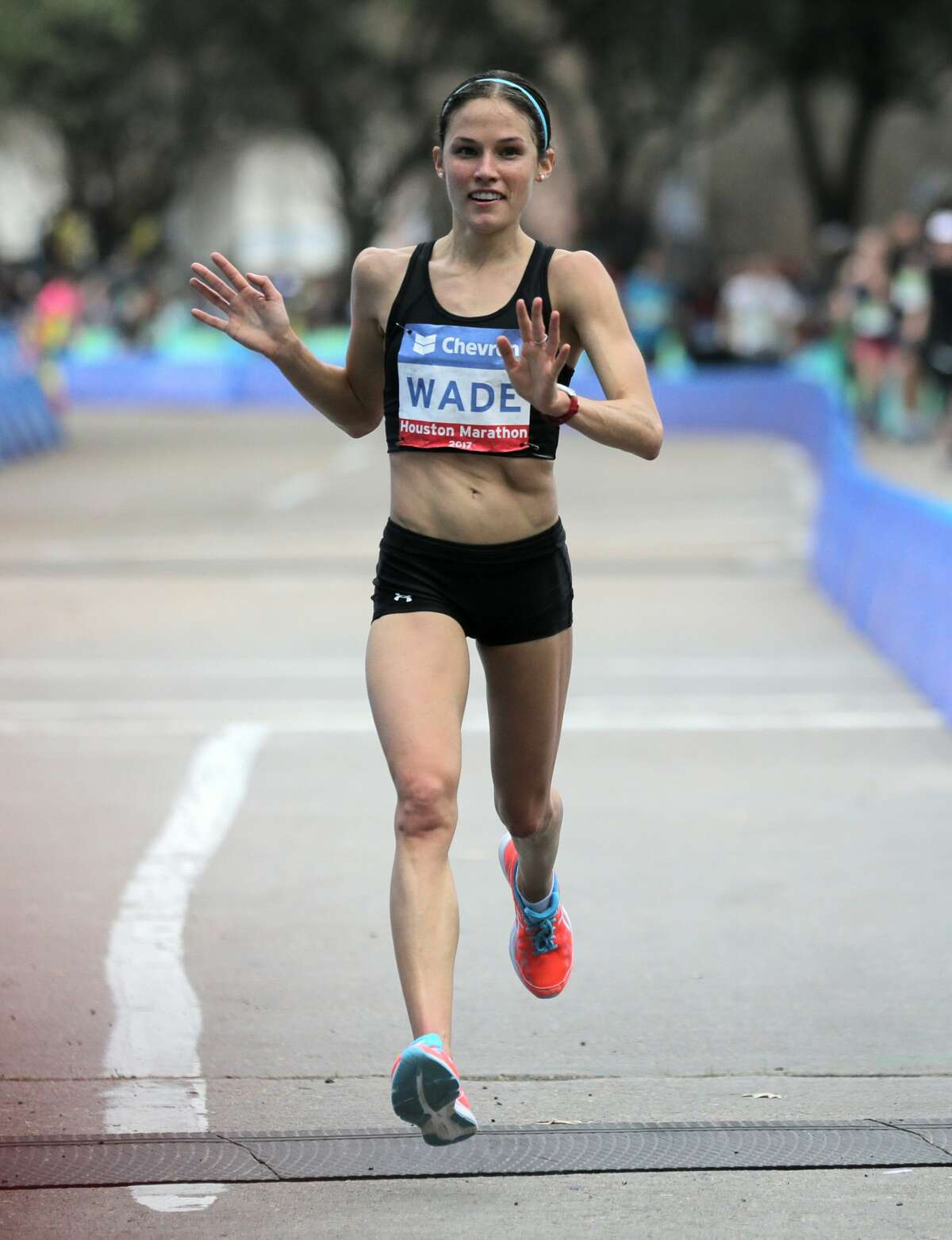 Becky Wade of the USA waves as she crosses the finish line after coming third in the Chevron Houston Marathon on Sunday, Jan. 15, 2017, in Houston. ( Elizabeth Conley / Houston Chronicle )