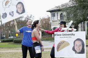 Lauren (left) and Nancy Eisenmenger greet Sara in the Tanglewood area during the Chevron Houston Marathon in Houston, TX on Sunday, September 15, 2017.  This is Sara Eisenmenger's first marathon.