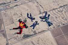 The CT True Blue skydiving team created formations in freefall during the National Collegiate Parachuting Championships in December 2016.