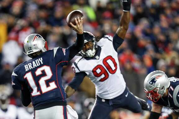 Houston Texans defensive end Jadeveon Clowney (90) attempts to block a pass by New England Patriots quarterback Tom Brady (12) during the third quarter of an NFL divisional playoff game at Gillette Stadium, Saturday, January 14,  2017.  ( Karen Warren / Houston Chronicle )