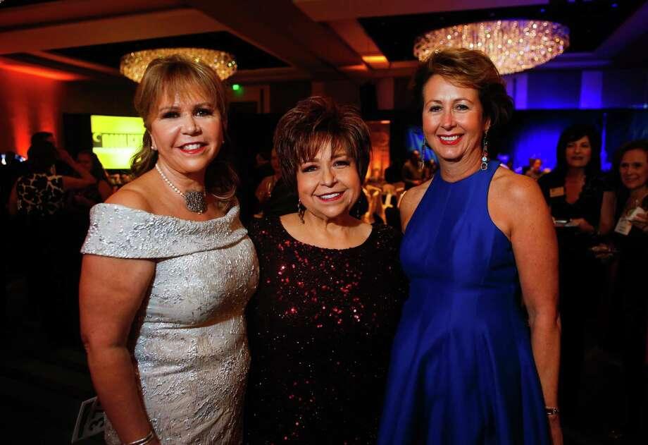 Chairs Cyndy Garza Roberts, Trini Mendenhall and Ileana Trevi–o at the Cristo Rey gala on Saturday, Jan. 14, 2017. (Annie Mulligan / Freelance) Photo: Annie Mulligan, Annie Mulligan / For The Houston Chronicle / @ 2017 Annie Mulligan & the Houston Chronicle