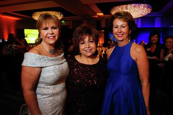 Chairs Cyndy Garza Roberts, Trini Mendenhall and Ileana Trevi–o at the Cristo Rey gala on Saturday, Jan. 14, 2017. (Annie Mulligan / Freelance)