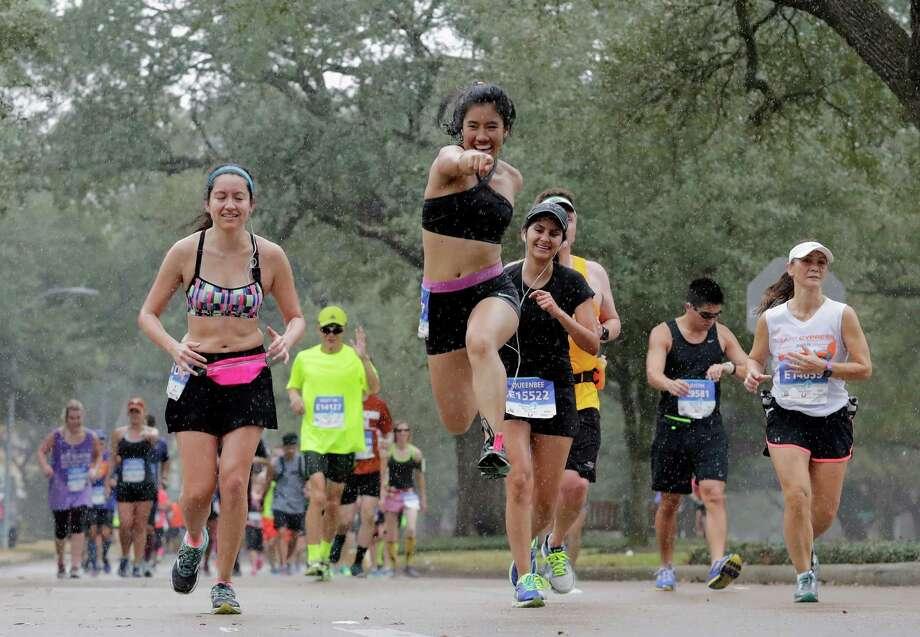 Runners brave the rain in the Tanglewood area during the Chevron Houston Marathon in Houston, TX on Sunday, September 15, 2017. Photo: Tim Warner, For The Chronicle / Houston Chronicle