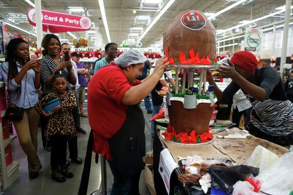 "Teams make and decorate cakes with the theme of ""Super Bowl 51- Football is Family"" during the sixth annual H-E-B Houston Region Cake-Off at the Pearland H-E-B Plus on Jan. 15, 2017."