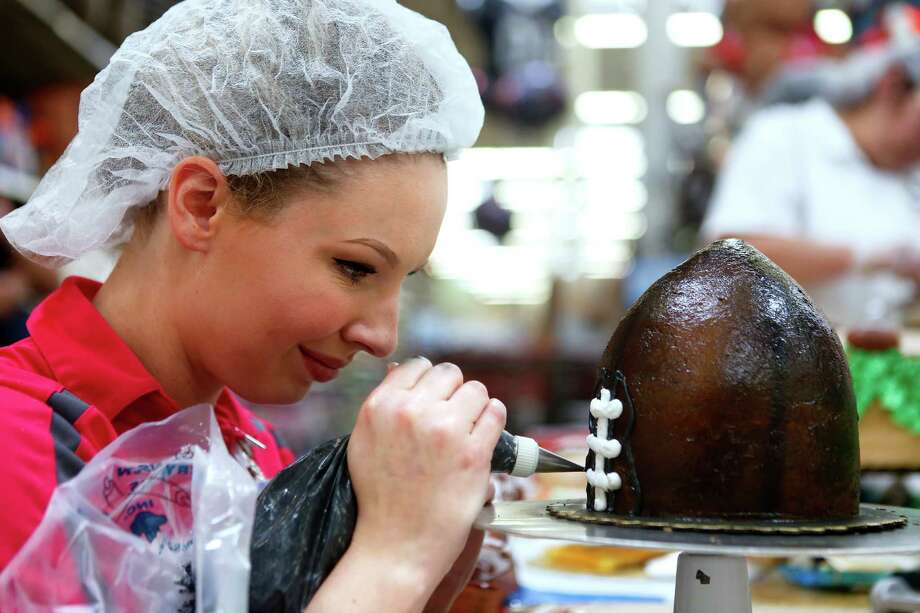 Stefani Stevenson adds detail to the laces of her football cake topper during the sixth annual H-E-B Houston Region Cake-Off at the Pearland H-E-B Plus on Jan. 15, 2017. Stevenson and her teammate Caleen Castonguay won second place at the competition. Photo: Annie Mulligan / 2016 Annie Mulligan