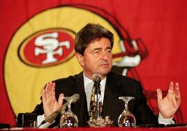 FILE -- San Francisco 49ers president and chief executive officer Carmen Policy answers questions during a news conference in Santa Clara, Calif., in this Dec. 3, 1997 photo. Policy is out as the San Francisco 49ers' president, and his replacement could be Bill Walsh, whose decade-long stay as coach coincided with the team's rise to power in the NFL. (AP Photo/Paul Sakuma)
