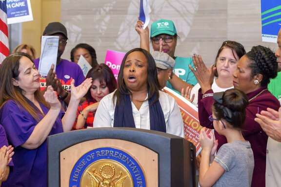 January 15, 2017:   Demetria Smith spoke about the death of her son because the Affordable Care Act was not in place during the time of his illness.  She implored the attendees to contact their congressional representatives and ask that the ACA not be repealed.  Health Care Rally at the Mickey Leland Federal Building in Houston, Texas.  (Leslie Plaza Johnson/Freelance)