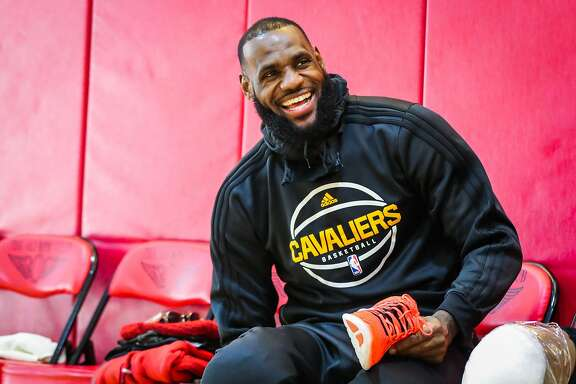 Cleveland Cavaliers forward LeBron James (23) laughs while packing up his belongings after a practice at the Olympic Club in San Francisco, Calif., on Sunday, Jan. 15, 2017.