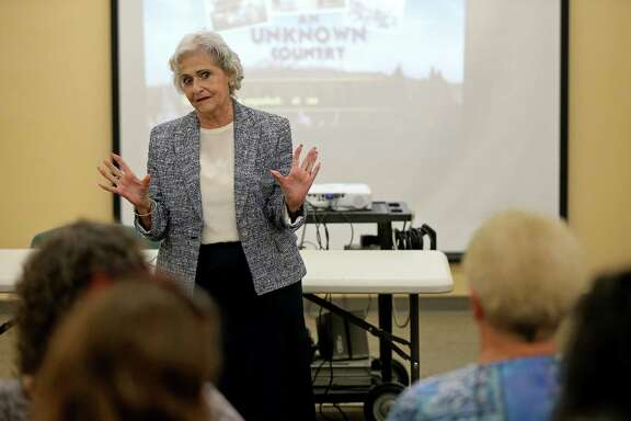 "Eva Balcazar speaks during a screening of ""An Unknown Coun- try: The Jewish Exiles of Ecua- dor"" on Saturday at the Great Northwest Branch Library. Balcazar's family escaped to Ecuador in November 1938."