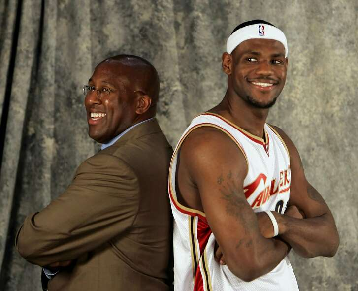 Cleveland Cavaliers' LeBron James, right, poses for a photographer with new coach Mike Brown during the team's media day Monday, Oct. 3, 2005, in Cleveland. The Cavaliers open training camp Tuesday. (AP Photo/Mark Duncan)