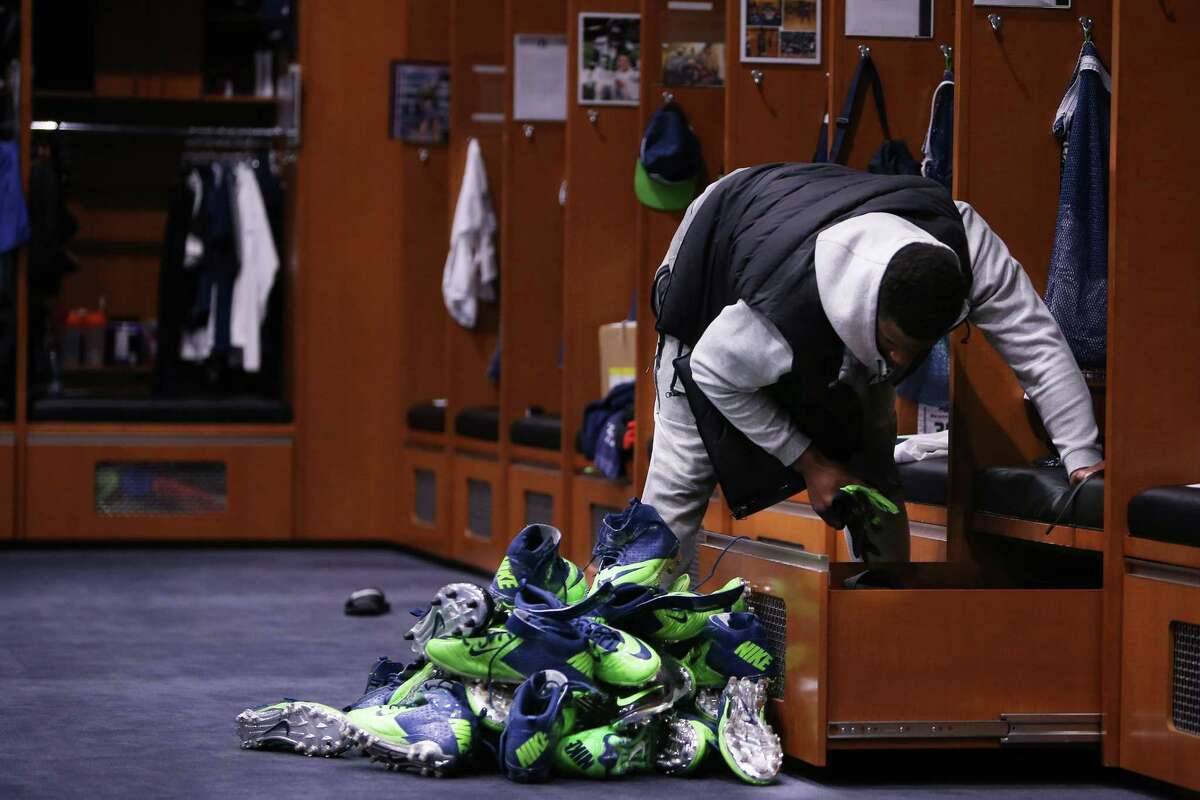 Seahawks tight end Brandon Williams cleans out shoes from his locker on locker clean out day, after the team played their final game of the season, Sunday, Jan. 15, 2017 at Virginia Mason Athletic Complex.