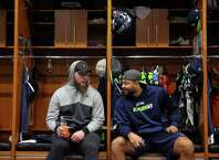 Seahawks Justin Britt, left, and Garry Gilliam talk as players clean out their lockers the day after the Seahawks played their final game of the season against Atlanta, Sunday, Jan. 15, 2017 at Virginia Mason Athletic Complex.