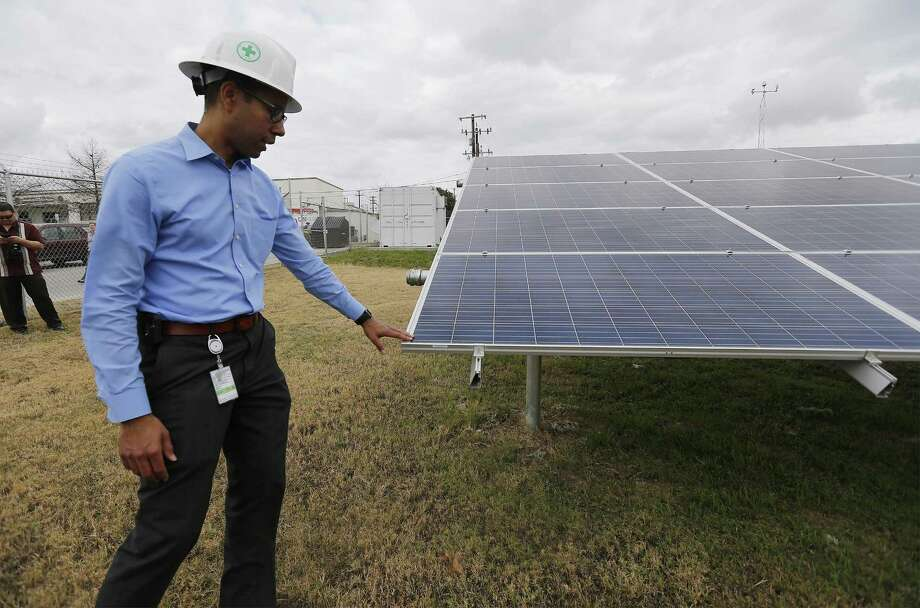 CPS Energy's James Boston, manager of market intelligence, tours the microgrid installation at JBSA-Fort Sam Houston. The microgrid is one of many initiatives the military is exploring to provide better energy security for America's military bases. Photo: Kin Man Hui /San Antonio Express-News / ©2017 San Antonio Express-News