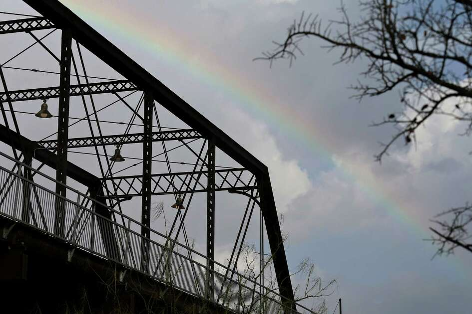 A rainbow is pictured behind the Hays Street Bridge as storms move through the area Sunday Jan. 15, 2017.