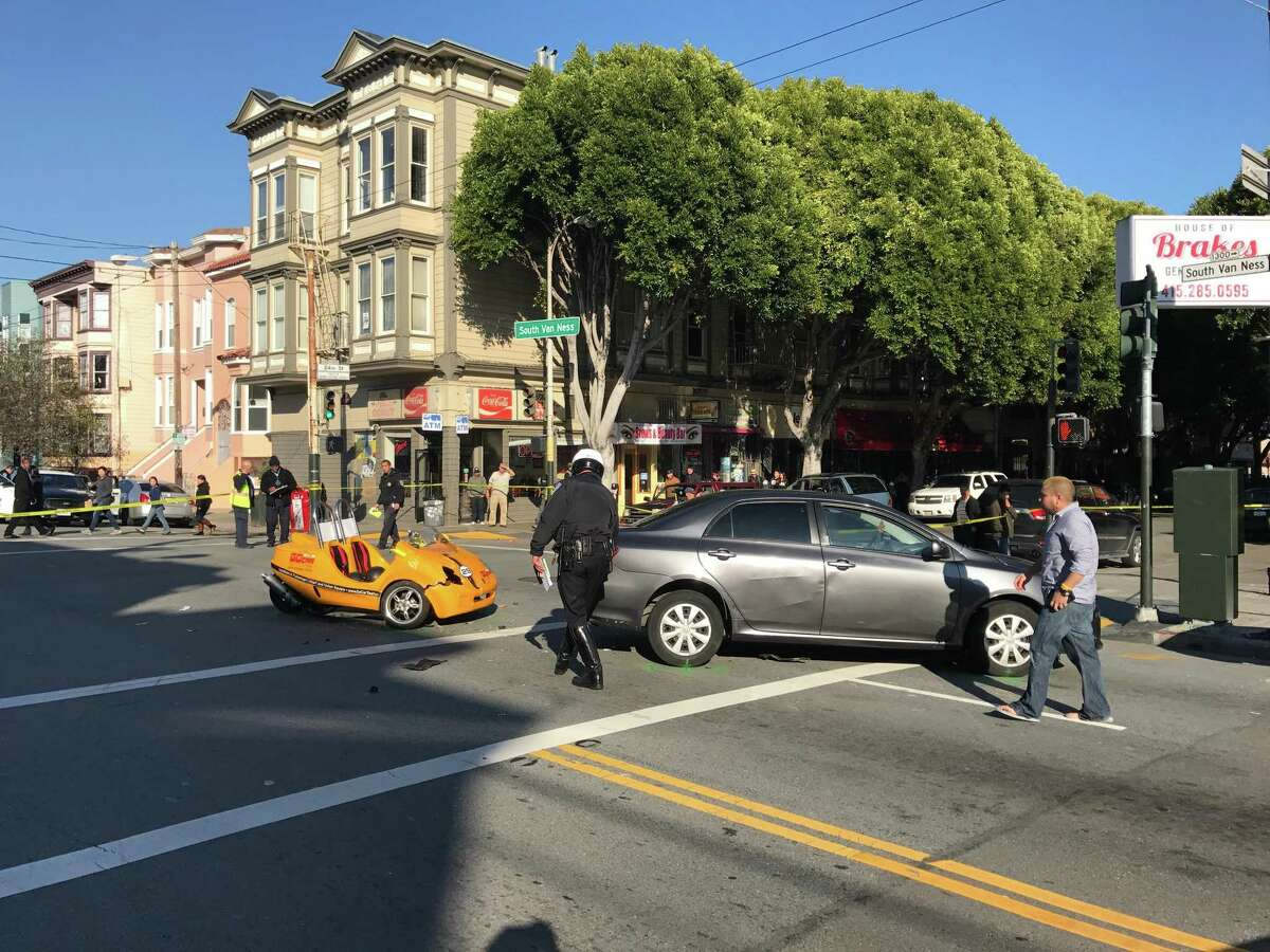 Two people in a GoCar were injured in a wreck in San Francisco's Mission District on Sunday.