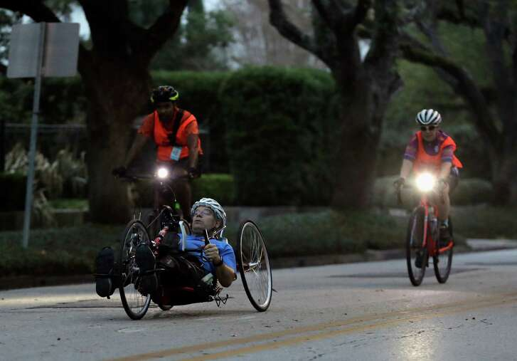 Bill Sass competes on the marathon route near Rice on Sunday. Sass completed the course in 1 hour, 42 minutes, 9 seconds to finish first among male handcyclists.