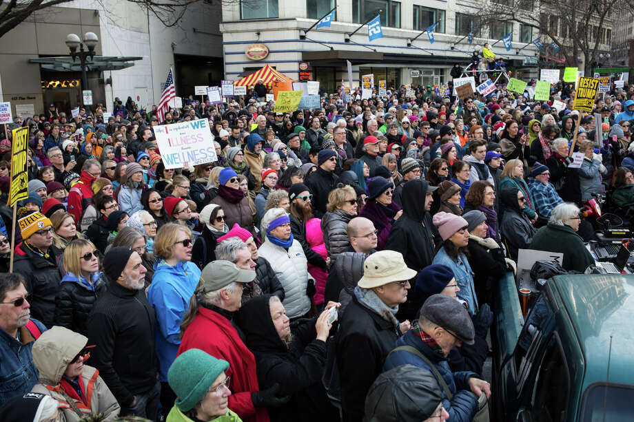 People gather to protest the push by Republican-lead government towards defunding the Affordable Care Act, at Westlake Park on Sunday, Jan. 15, 2017.A new Gallup Poll shows that 55 percent of Americans support Obamacare, its highest ever approval rating.  (GRANT HINDSLEY, seattlepi.com) Photo: GRANT HINDSLEY
