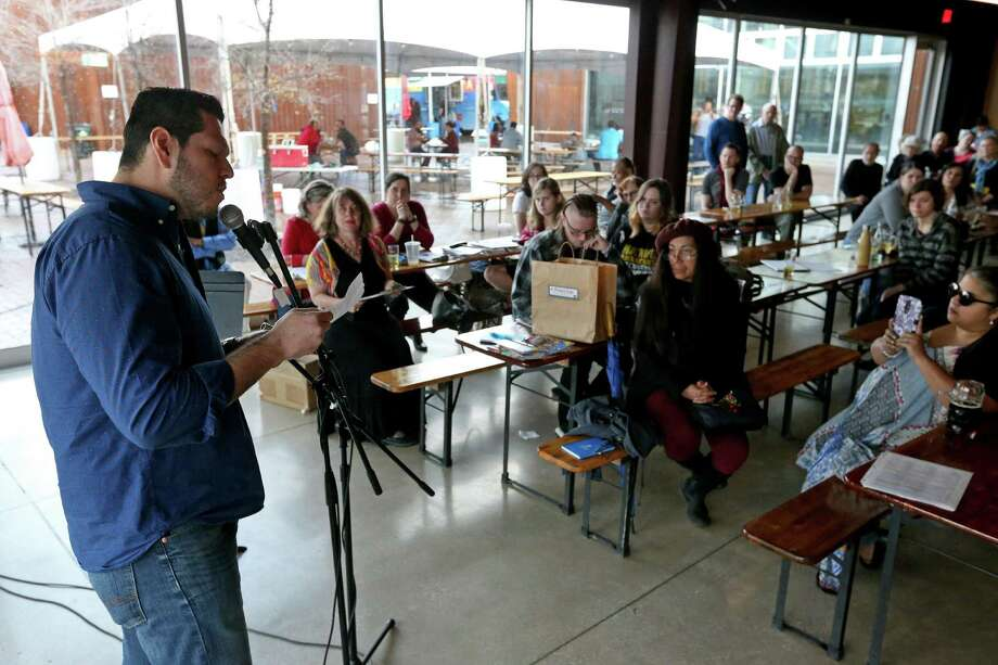 """Gerard Robledo reads his poem """"And some, I assume, are good people"""" during the Writers Resist in San Antonio event held Sunday Jan. 15, 2017 at the Alamo Beer Company. Photo: Edward A. Ornelas, Staff / San Antonio Express-News / © 2017 San Antonio Express-News"""