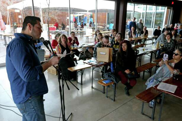 """Gerard Robledo reads his poem """"And some, I assume, are good people"""" during the Writers Resist in San Antonio event held Sunday Jan. 15, 2017 at the Alamo Beer Company."""