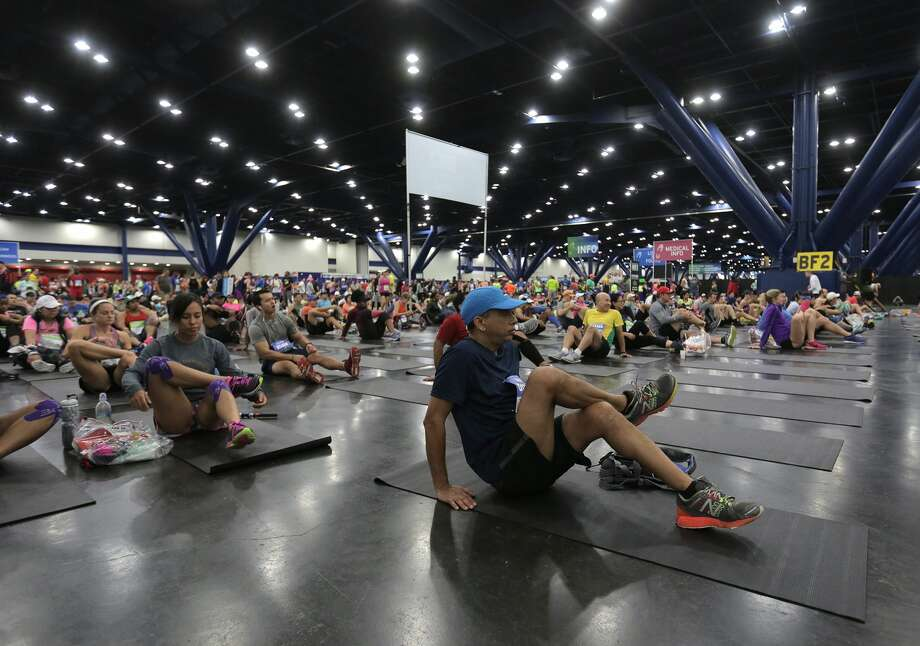 Runners stretch out at the George R. Brown Convention Center before the Houston Marathon on Sunday, Jan. 15, 2017, in Houston. ( Elizabeth Conley / Houston Chronicle ) Photo: Elizabeth Conley/Houston Chronicle