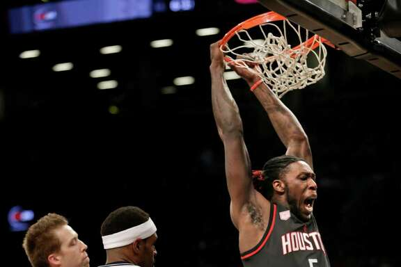 The Rockets' Montrezl Harrell, right, dunks on the Nets' Trevor Booker during the first half for two of his 16 points in the win Sunday at Barclays Center.