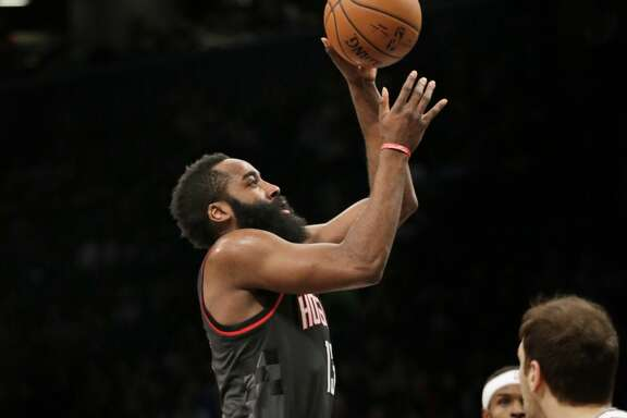 Houston Rockets' James Harden drives to the basket during the first half of the NBA basketball game against the Brooklyn Nets at the Barclays Center, Sunday, Jan. 15, 2017 in New York. (AP Photo/Seth Wenig)