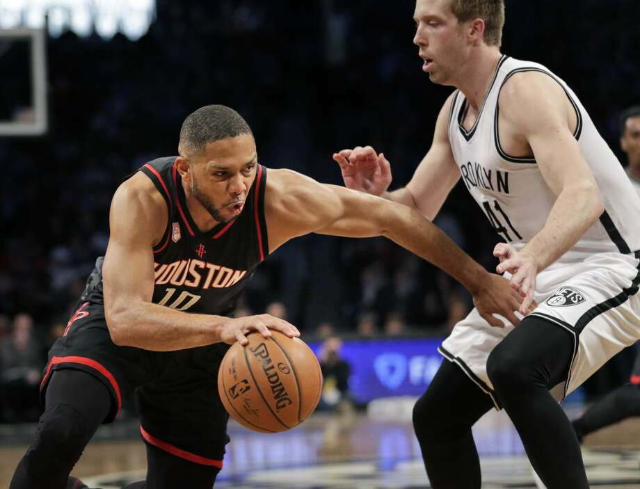 Houston Rockets' Eric Gordon, left, pushes past Brooklyn Nets' Justin Hamilton during the first half of the NBA basketball game at the Barclays Center, Sunday, Jan. 15, 2017 in New York. (AP Photo/Seth Wenig) Photo: Seth Wenig/Associated Press