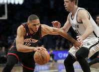 Houston Rockets' Eric Gordon, left, pushes past Brooklyn Nets' Justin Hamilton during the first half of the NBA basketball game at the Barclays Center, Sunday, Jan. 15, 2017 in New York. (AP Photo/Seth Wenig)