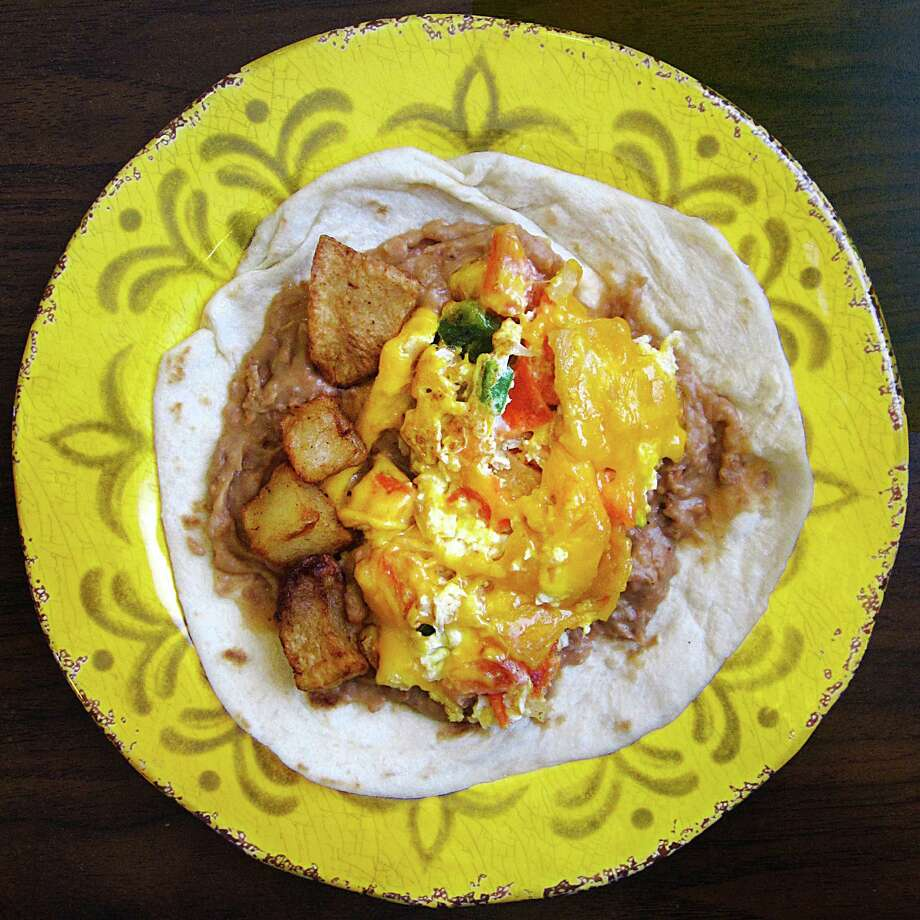 A migas taco on a handmade flour tortilla put together from a full migas platter from Taqueria Chapala Jalisco on McCullough Avenue in San Antonio. For the 365 Days of Tacos Series. Photo: Mike Sutter, San Antonio Express-News