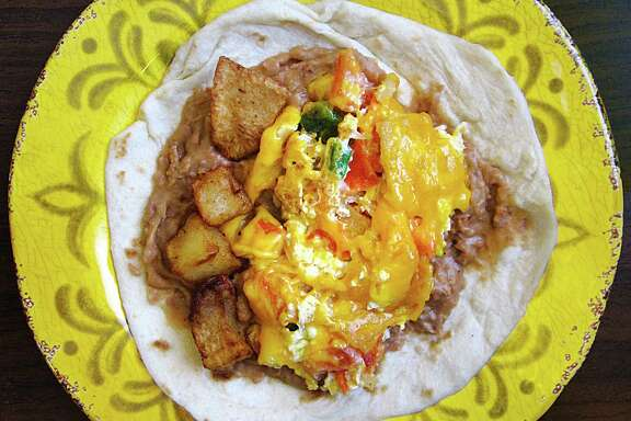 A migas taco on a handmade flour tortilla put together from a full migas platter from Taqueria Chapala Jalisco on McCullough Avenue in San Antonio. For the 365 Days of Tacos Series.