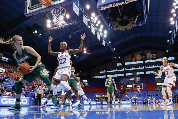 Baylor guard Kristy Wallace, left, looks for an opening to pass around Kansas guard Chayla Cheadle (22) during Sunday's game in Lawrence, Kan.